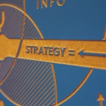 "A board showing an arm holding a spanner emblazoned with the word ""Strategy""."